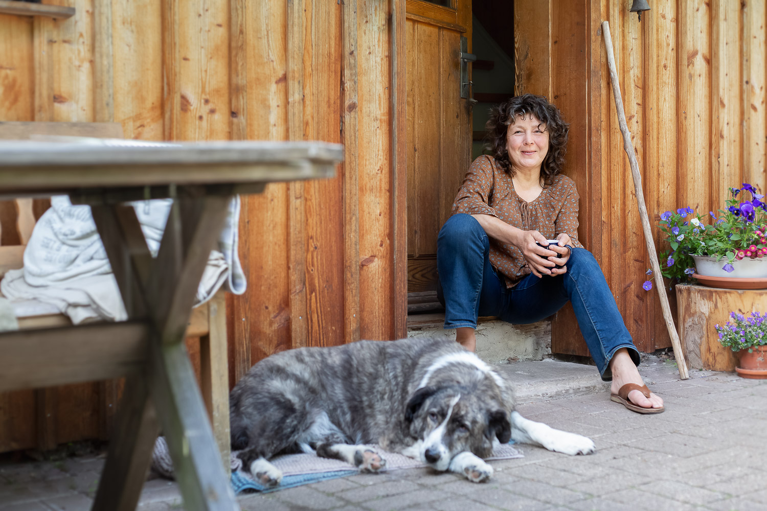 Portrait of woman with her dog, sitting in front of their home , Homepage, Andrea Schenke Photography, Wittlich