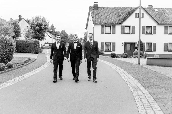 Groom and groomsmen, b&w, on the street, Wedding, Hochzeit, Hochzeitsfotograf Wittlich, Andrea Schenke Photography