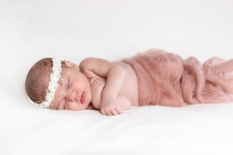 Closeup of an Newborn with a flower-bead